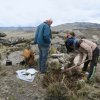 img-20181116-wa0007  cleaning outcrops in the same area as historical sample esc-26. soil will significantly block total count radioactivity readings on the scintillometer. - copy